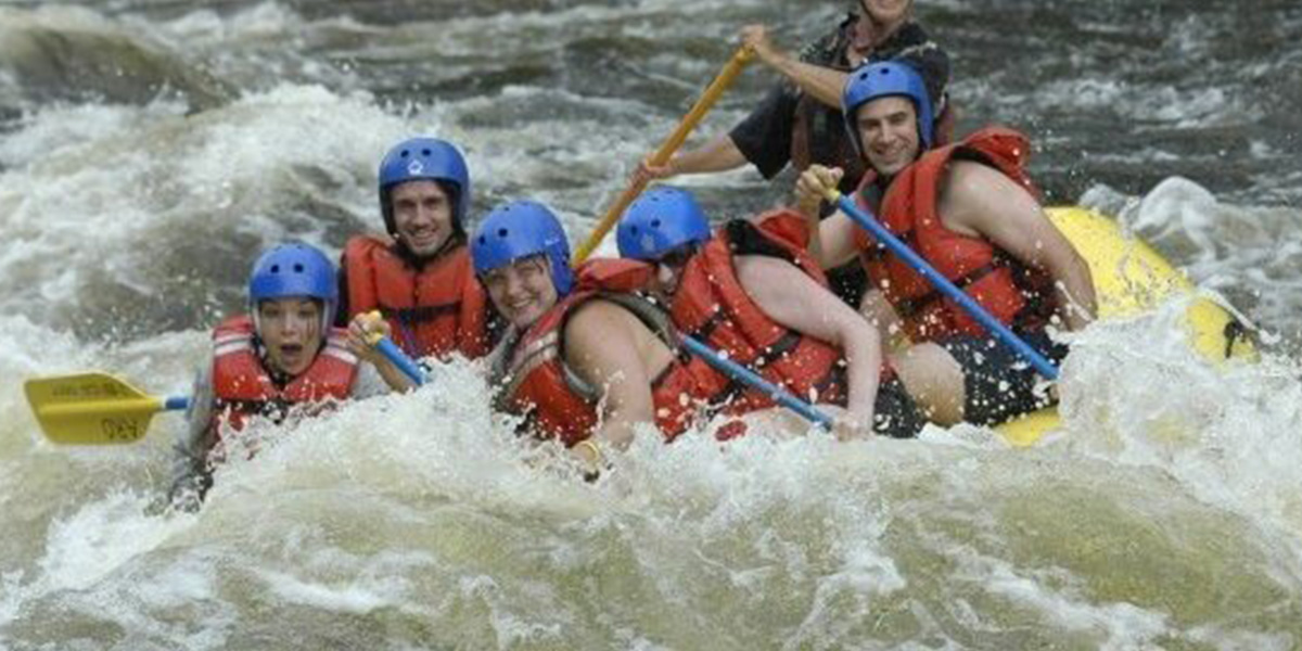 Shira Boyle whitewater rafting during travels